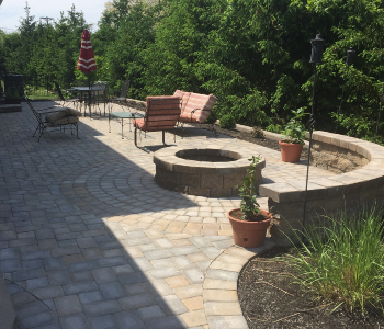 outdoor patio area with stone pavers and firepit